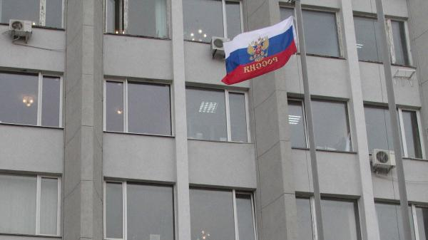 A Russian flag flies outside the state and city administration building in the Crimean city of Sevastopol on Monday.
