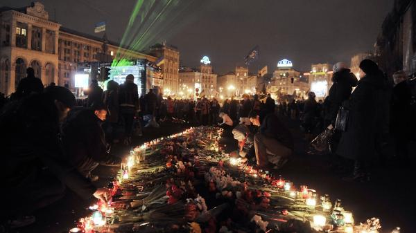 People light candles to honor victims of recent clashes between protesters and police on Independence Square in Kiev Monday. NATO and Russian officials shared their concerns about Ukraine's stability.