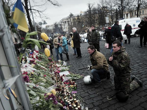 <strong>Praying For Those Who Died:</strong> Mourners were in Kiev's Independence Square again on Tuesday. It was the site of protests in recent months, and was where more than 80 people died last week in violence blamed on security forces.