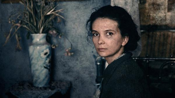 Teenage civilian Katya (Mariya Smolnikova) shares a ruined apartment with a gang of Soviet soldiers during the battle of Stalingrad in Fedor Bondarchuk's <em>Stalingrad.</em>