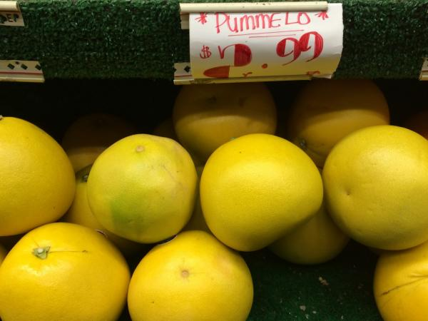 Pummelos for sale. The fruit can also be spelled pomelo or pommelo. (Kathy Gunst/Here & Now)