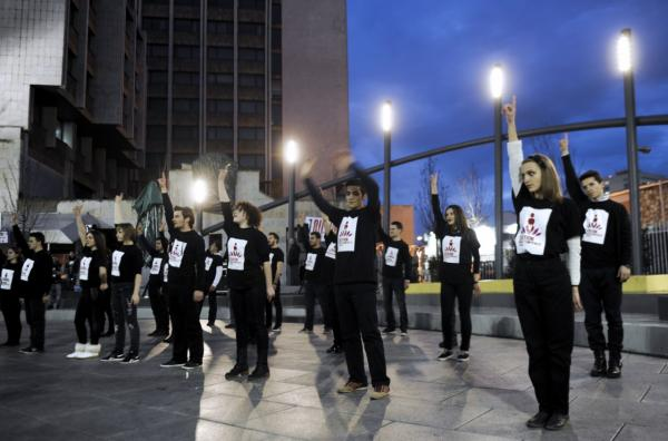 Volunteers dance during the One Billion Rising campaign in the city center of Pristina, Kosovo, on February 14, 2014. (Armend Nimani/AFP/Getty Images)