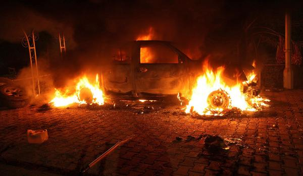 "A vehicle inside the U.S. Consulate compound in Benghazi is engulfed in flames after an attack on Sept. 11, 2012. ""There is no evidence whatsoever that al-Qaida or any group linked to al-Qaida played a role in organizing or leading the attack,"" says <em>New York Times</em> correspondent David Kirkpatrick."