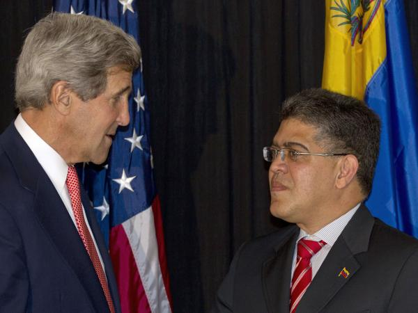 U.S. Secretary of State John Kerry (left) and Venezuelan Foreign Minister Elias Jose Jaua have tried to improve relations between the two nations, to no avail so far. They're shown here in Guatemala in June 2013.