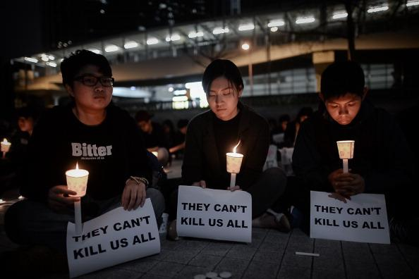 Protesters hold candles during a demonstration in support of the former editor of the Hong Kong newspaper Ming Pao, Kevin Lau, who was stabbed in Hong Kong on February 27. Lau is currently in stable condition.  (Phillipe Lopez/AFP/Getty Images)
