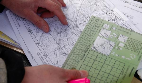 Team leader Ruth Hanson maps out an area for Kia to search. Today she was searching 40 acres. To earn Yakima County certification, she must search 80 acres.