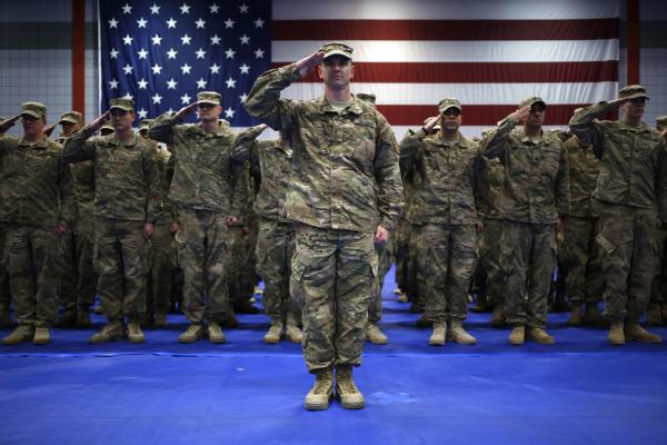 Soldiers from the U.S. Army's 3rd Brigade Combat Team, 1st Infantry Division, salute during the playing of the Star Spangled Banner, Feb. 27, 2014 in Fort Knox, Kentucky. (Luke Sharrett/Getty Images)