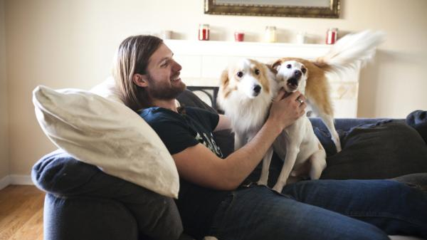 "Chris Stephens, 28, who has been battling depression all of his life, plays with his dogs at home in Concord, Calif., on Friday. After a dose of ketamine, Stephens says, ""I actually wanted to do things. I wanted to live life."""