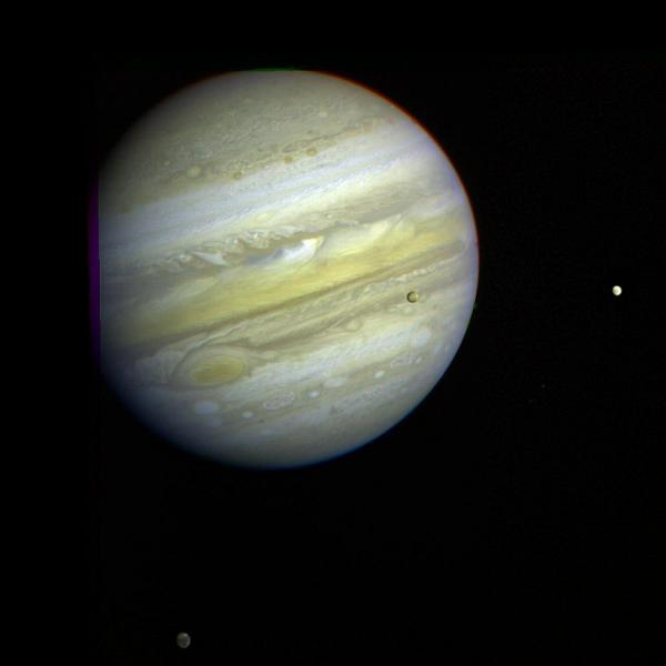 As Voyager 1 passed by Jupiter on Feb. 5, 1979, it captured this image of the planet and its Great Red Spot, as well as three of its four largest moons — Io, Europa and Callisto.