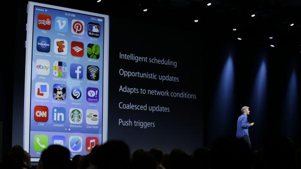 Craig Federighi, senior vice president of software engineering at Apple, discusses features of the new iOS 7 during the keynote address of the Apple Worldwide Developers Conference on June 10 in San Francisco.