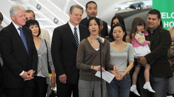 Freed U.S. journalist Laura Ling (center) speaks after she and her sister, fellow journalist Euna Lee (3rd from right), arrived in Burbank, Calif., from North Korea on Aug. 5, 2009. After talks in Pyongyang with former U.S. President Bill Clinton (left), then-North Korean leader Kim Jong Il pardoned the women, who were sentenced to hard labor for entering the country illegally.