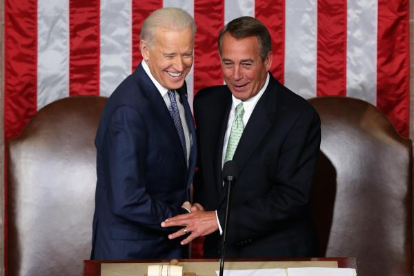 Biden and Boehner shake hands.