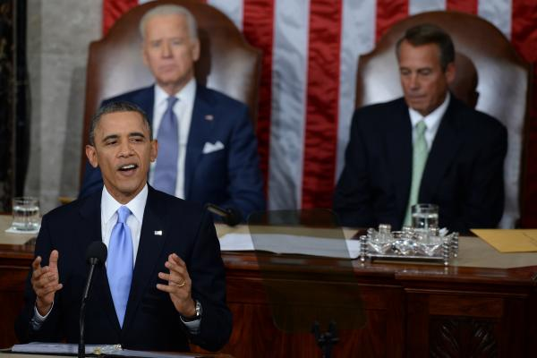 With Vice President Biden and House Speaker John Boehner, R-Ohio, seated behind him, Obama called on Congress to pass immigration reform.
