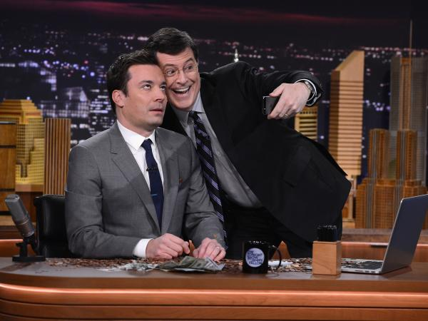 "Stephen Colbert visits <em>The Tonight Show</em> for Jimmy Fallon's debut --€"" and pays up the $100 he bet that Fallon would never host it."
