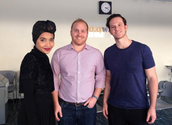 Here & Now host Jeremy Hobson (center) is pictured with Yuna and Lincoln Jesser. (Here & Now)