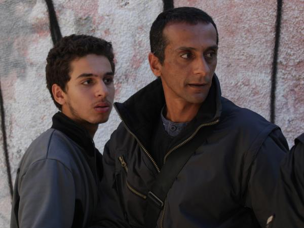 Yuval Adler's <em>Bethlehem </em>tells the story of Sanfur (Shadi Mar'i, left), the younger brother of a wanted Palestinian militant — and secret informant to Razi (Tsahi Halevy), the Israeli agent who wants that brother dead.