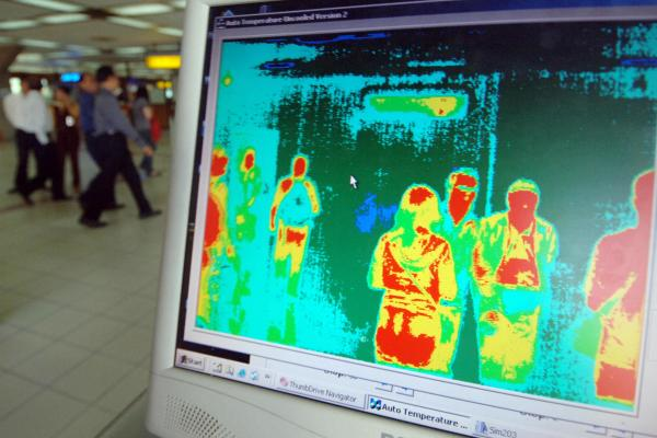 Images from a thermal imaging scanner are pictured on a computer screen at Bali's international airport.