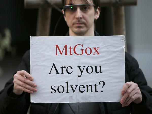 <strong>Apparently Not:</strong> A protester holds a placard Tuesday during a demonstration in front of the offices of Mt. Gox, a Bitcoin exchange in Tokyo. On Friday, Mt. Gox filed for bankruptcy protection.