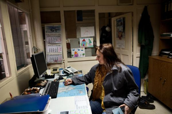 Tsitoura visits her old workplace, where she was a secretary at Hellenic Shipyards. As Greece's economy continues to buckle under the weight of massive government debt, some Greeks are relying on their ties to family and friends to put food on the table and provide other basic necessities.