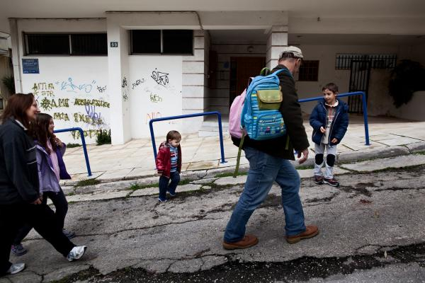 Tsitoura and Aivatzidis walk home from school with their children, Dimitris, 6, Fani, 9, and Marios, 2, in Athens.