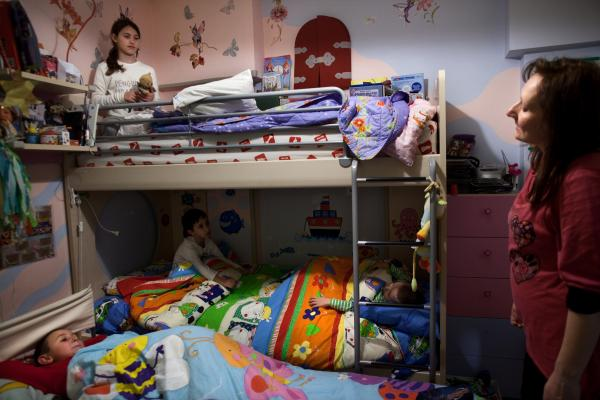 Tsitoura makes sure the children are ready for bed. Her brother and their children were visiting from Kalamata, so all of the children slept together in Fani, Dimitris, and Marios' room.