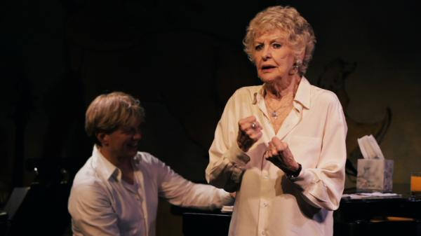Fists balled and feet planted, cabaret legend Elaine Stritch powers through a song with her longtime music director, Rob Bowman, in a scene from <em>Elaine Stritch: Shoot Me.</em>