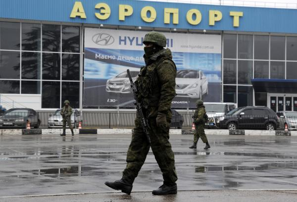 Unidentified armed men patrol outside of Simferopol airport, on February 28, 2014. Ukraine accused today Russia of staging an 'armed invasion' of Crimea and appealed to the West to guarantee its territorial integrity after pro-Moscow gunmen took control of the peninsula's main airport. (Viktor Drachev/AFP/Getty Images)