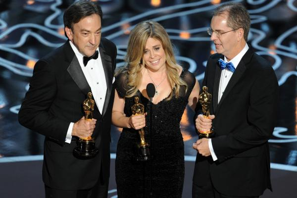 Producer Peter Del Vecho (left) and directors Jennifer Lee and Chris Buck won Oscars for their animated feature <em>Frozen.</em>