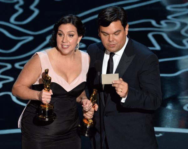 "Songwriters Kristen Anderson-Lopez (left) and Robert Lopez won the Original Song award for ""Let It Go,"" from Disney's <em>Frozen, </em>and accepted with a charming rhymed speech. With his win, Robert Lopez joined the EGOT club — becoming the 12th person to win an Emmy, a Grammy, an Oscar and a Tony."