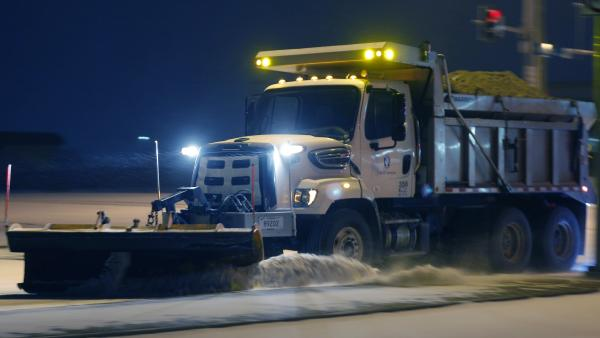 On the road again: This plow was at work on Sunday in Lawrence, Kan. The storm that hit there has spread east.