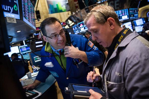 Traders work on the floor of the New York Stock Exchange on the morning of March 3, 2014 in New York City. The Dow Jones Industrial Average opened down amidst turmoil between Russia and Ukraine. (Andrew Burton/Getty Images)