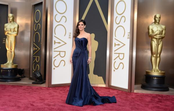 Nominee for Best Actress in 'Gravity' Sandra Bullock arrives on the red carpet for the 86th Academy Awards on March 2nd, 2014 in Hollywood, California. (Robyn Beck/AFP/Getty Images)