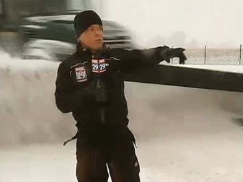 A reporter about to get pummeled by a plow.