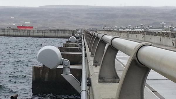 A recent photo of the Wanapum Dam shows a slight bend in the conduit below a guardrail along the roadway. A county employee spotted that curve, sparking the discovery of a long crack.