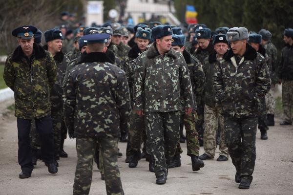 Unarmed Ukrainian troops gather outside their garrison before marching to confront soldiers under Russian command occupying the nearby Belbek airbase in Crimea on March 4, 2014 in Lubimovka, Ukraine. (Sean Gallup/Getty Images)