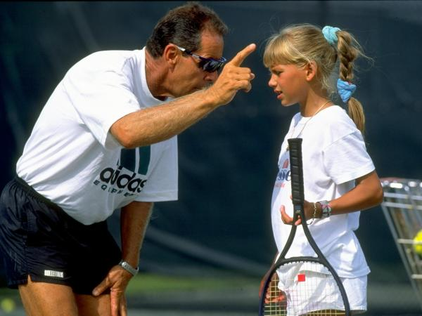 Tennis Coach Nick Bollettieri gives instructions to a young Anna Kournikova of Russia during a training session at his tennis academy in Bradenton, Fla., in 1990. Kournikova went on to become a highly ranked international player, but she ended her career at age 21 because of injuries.