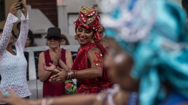 Revelers participate in a block street carnival on Sunday in downtown Sao Paulo.