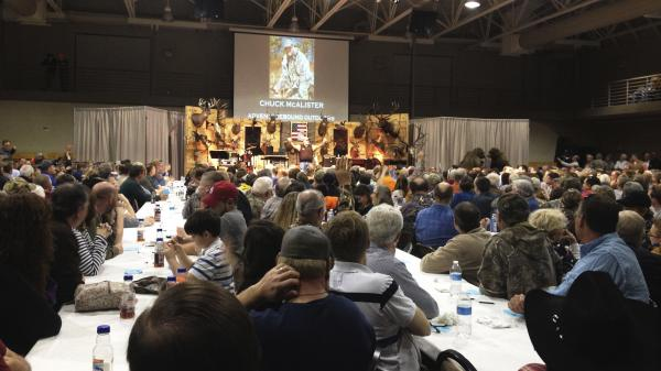 A crowd of 1,300 talks guns, God and politics at a steak dinner and gun raffle at Lone Oak First Baptist Church in Paducah, Ky.