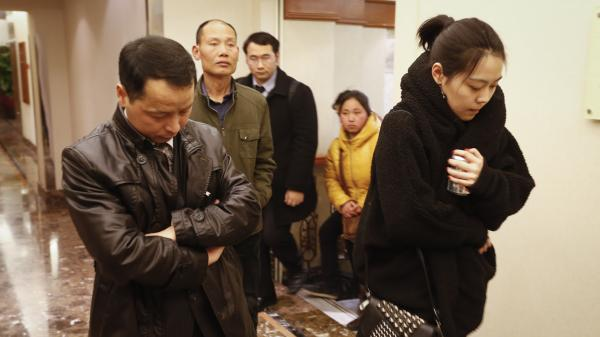 Family members arrive at a hotel for loved ones of passengers aboard a missing Malaysia Airlines jet in Beijing Sunday. Search teams across Southeast Asia scrambled on Saturday to find a Malaysia Airlines Boeing 777 with 239 people on board that disappeared from air traffic control screens over waters between Malaysia and Vietnam.