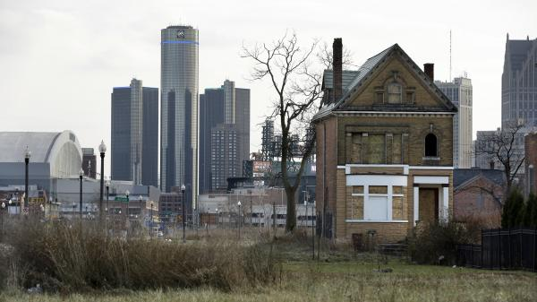 An abandoned home sits in an empty field in Brush Park, north of Detroit's downtown. The city is trying to recover from the largest municipal bankruptcy case in American history.