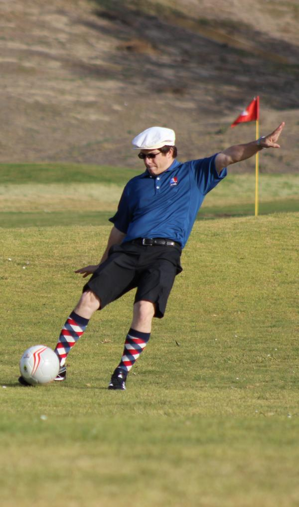 A FootGolfer, in argyle socks.