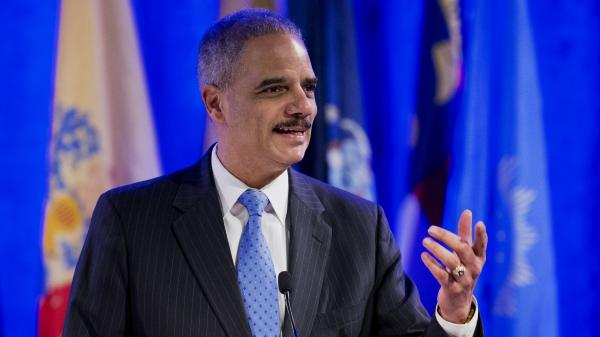 Already one of the longest-serving attorneys general in history, Eric Holder says he has no immediate plans or timetable to leave. Here, he speaks at the annual Attorneys General Winter Meeting in Washington on Feb. 25.