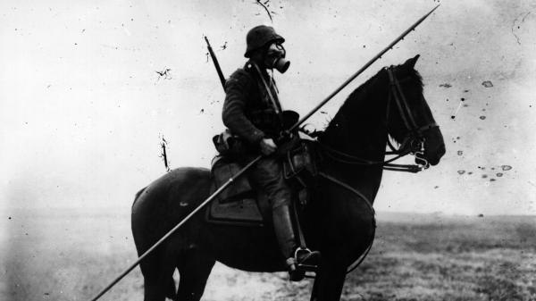 World War I was when the old world became the new. Here, a German cavalryman wears a gas mask and carries a long spear or pole, from two different ages of war.