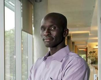 Mangok Bol, pictured here at Brandeis University, returned to his native Sudan to find his orphaned nieces and nephew. (Mike Lovett/Brandeis University)