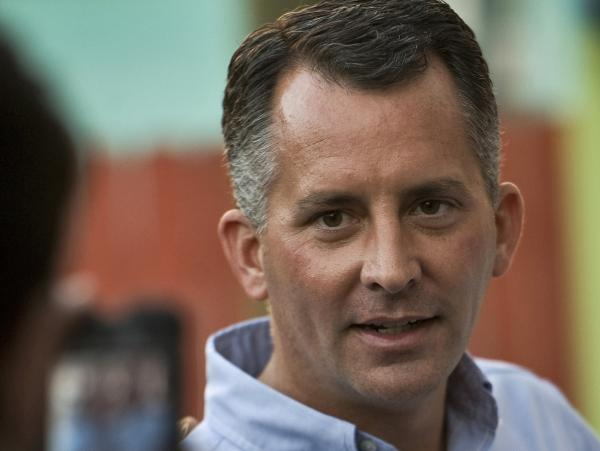 Republican David Jolly, shown during a Nov. 23 campaign rally in Indian Rocks Beach, Fla., once worked for the late congressman whose seat he's vying to fill. He has called for repeal of President Obama's health care law.