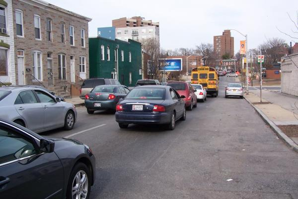 Cars wait at a red light on 28th Street after getting off of I-83.