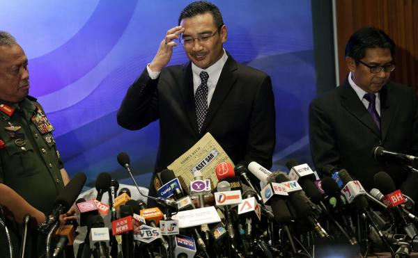 Scratching their heads: Malaysia's minister of transport, Hishamuddin Hussein (center), tried to answer reporters' questions Wednesday about the disappearance of Malaysia Airlines Flight 370. He was joined by Azharuddin Abdul Rahman, director general of the Malaysian Department of Civil Aviation, and Gen. Zulkifeli Mohd Zin.