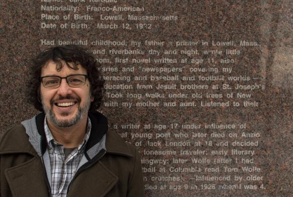 "Todd Tietchen, who edited Jack Kerouac's ""The Haunted Life,"" is pictured at Kerouac Memorial Park. The stone is engraved with words from Kerouac's  this writing comes from Kerouac's ""Lonesome Traveler."" (Casey Ashlock)"