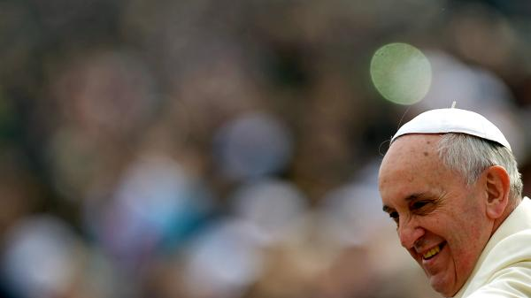 Pope Francis greets the crowd as he arrives for his general audience in St. Peter's Square at the Vatican last month.