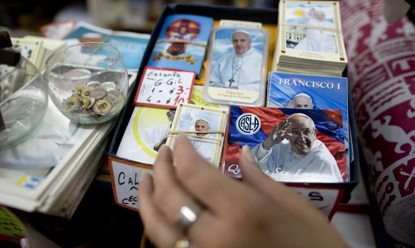 A box containing stamps, postcards and souvenir cards, adorned with the image of Pope Francis, on display at a shop in Buenos Aires, Argentina. In his first year as pope, Francis has endeared himself to the public.